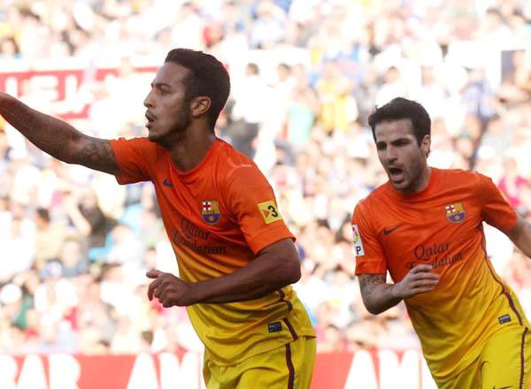Barcelona's Thiago Alcantara (L) and Cesc Fabregas celebrate a g