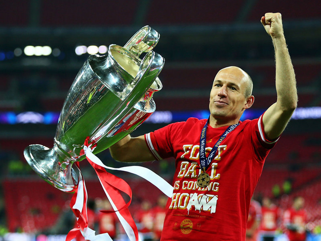 Robben was happy to pose with the trophy.