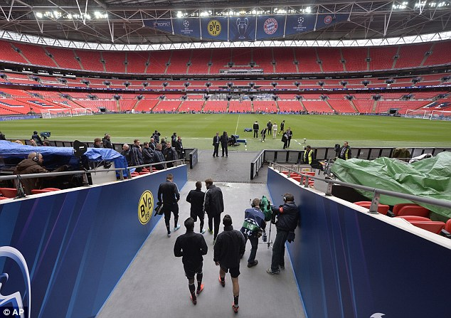 Tunnel walk: Bayern Munich players walk out onto the Wembley pitch for a training session