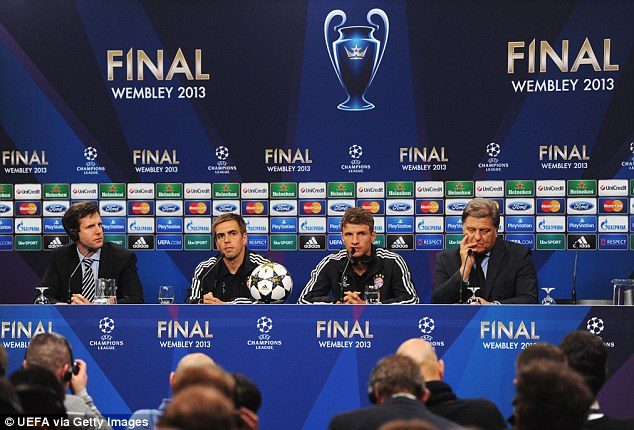 Press talk: Bayern's Philipp Lahm and Thomas Muller (above) and Dortmund coach Klopp (below) speak during a press conference ahead of the final