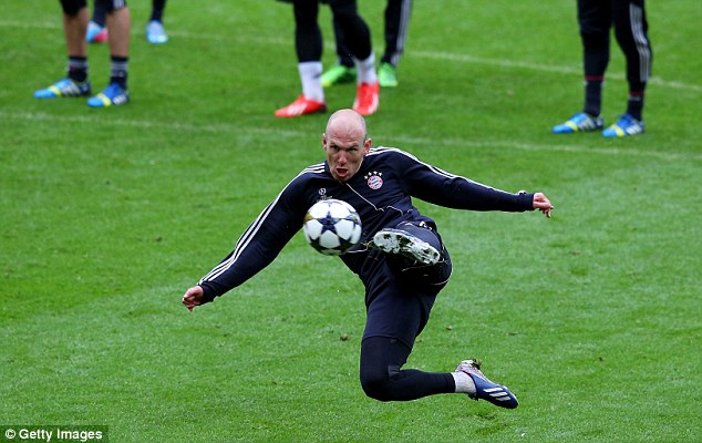 Shooting boots: Robben (above) and Ribery (below) get their shooting in order ahead of the final