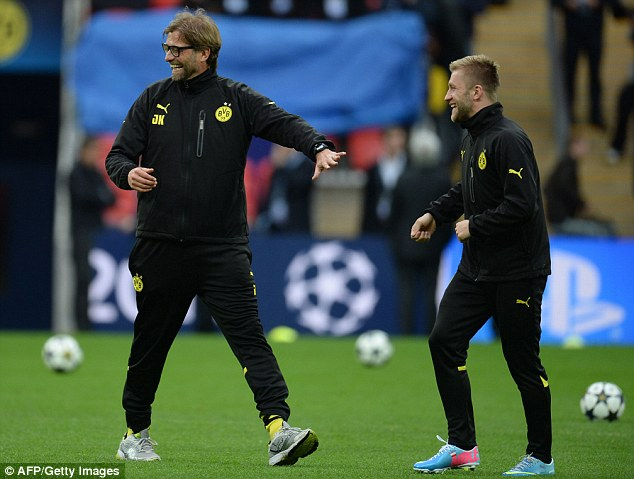 Fun stuff: Klopp shares a laugh with Jakub Blaszczykowski (above), before having a word with his players