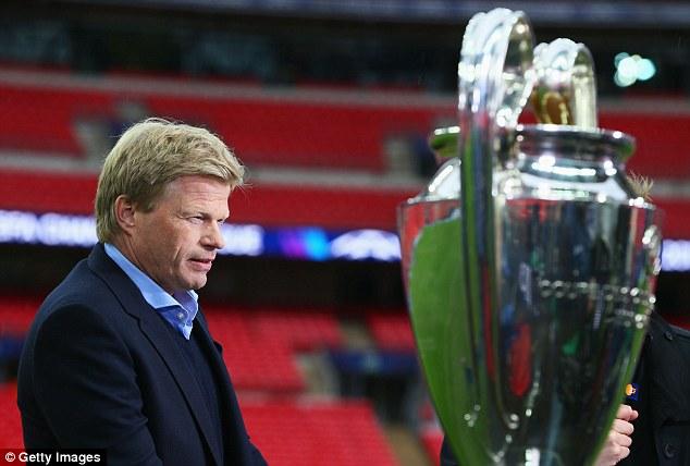 Legend: Former Bayern goalkeeper Oliver Kahn stands beside the Champions League trophy