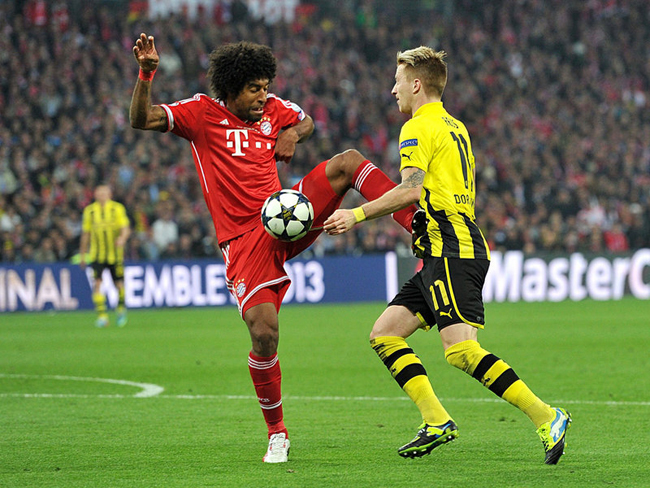 Dante fouled Marco Reus to give Dortmund a penalty.