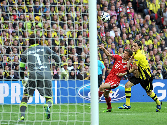 Neven Subotic and Thomas Muller battled for the ball early on.