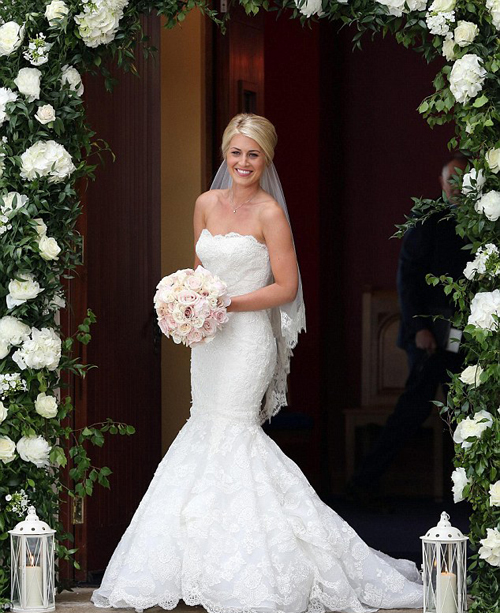 Classic beauty: Helen wore a strapless lace dress with a fishtail skirt with a vintage net veil