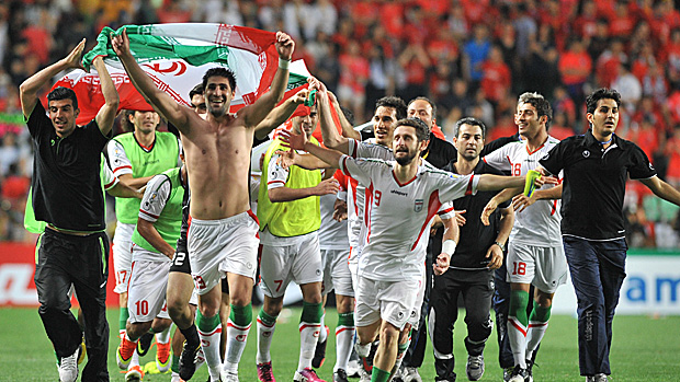 Iranian players celebrate their victory after their World Cup Asian qualifier football match in Ulsan, South Korea. (Jung Yeon-Je/AFP/Getty Images)