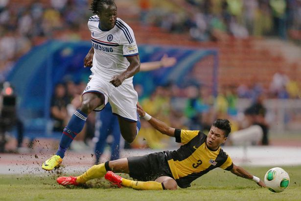 Chelsea's Romelu Lukaku (L) in action with Malaysia's Azizi Matt Rose