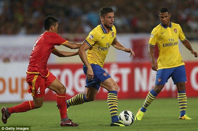 Break through: Giroud strides past his opponent during a very straightforward victory for Arsenal