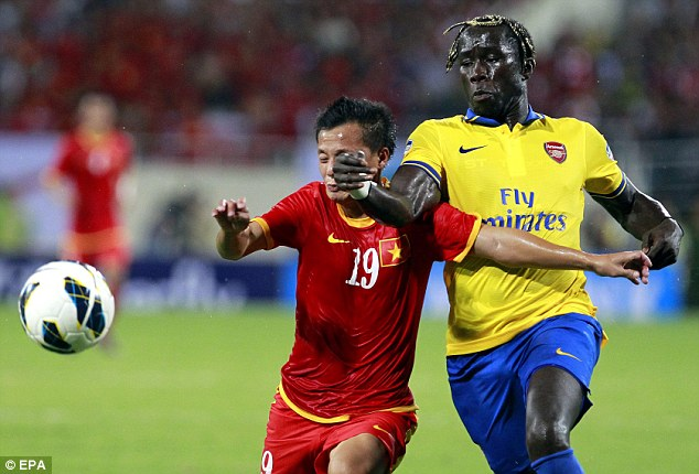 Battle: Vietnam's Pham Thanh Luong vies for the ball with Arsenal's Bacary Sagna