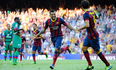 Dani Alves celebrates after scoring Barcelona's third goal against Levante. Photograph: David Ramos/Getty Images