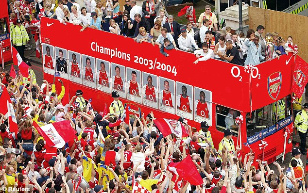 Victory bus: Arsenal fans crowd the streets of Islington in 2004 to congratulate the team during a victory parade in north London