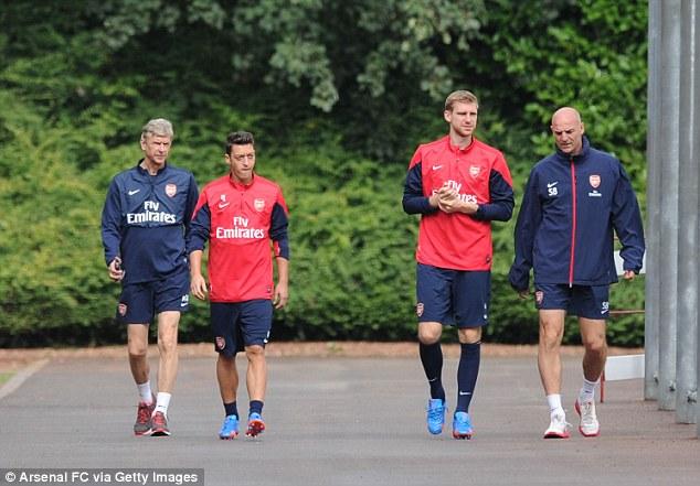 Colney training: Arsene Wenger, Mesut Ozil, Per Mertesacker and assistant manager Steve Bould