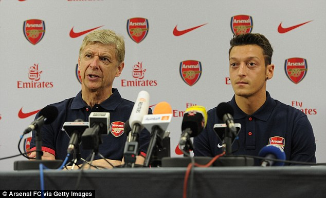 Uncertain future: Arsene Wenger lined up alongside new signing Mesut Ozil at Thursday's press conference