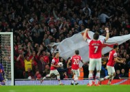 Flamini strike keeps City within touching distance