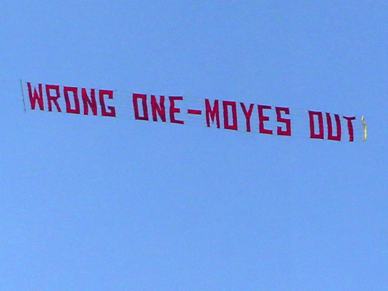 A plane flies overhead with a banner criticising Moyes during the match with Aston Villa. It proved a prelude to the end