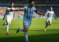 Messi strikes late to send Argentina through